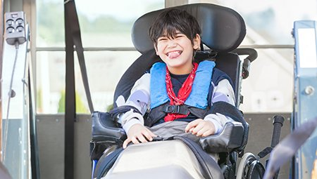 child in wheelchair transport